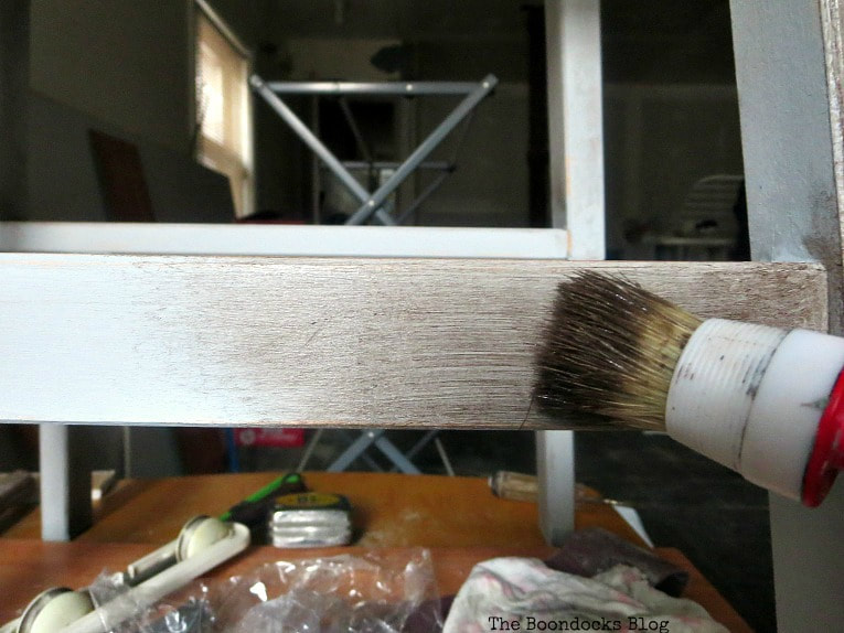 adding the dark wax with the round brush, How to get an Easy Worn Look for an Ikea Stool, www.theboondocksblog.com