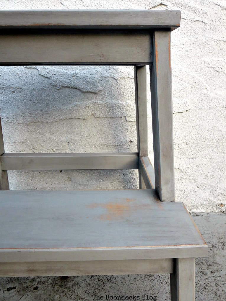 Close up of the distressed step stool.