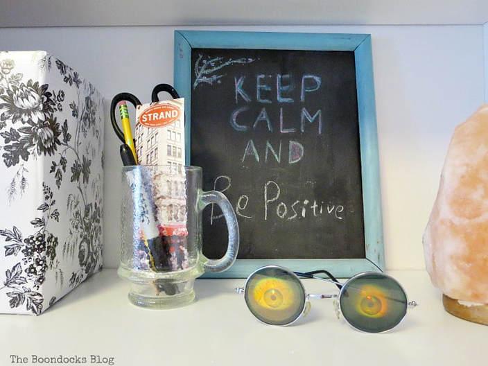 Framed chalkboard on shelf, A Bedframe Refresh and Progress in the Room www.theboondocksblog.com