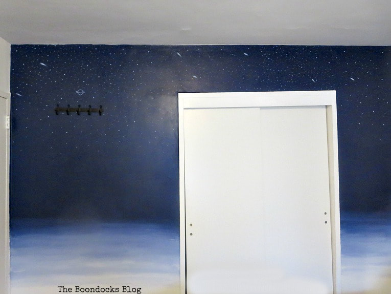 A close up of the outerspace ombre blue wall with a white closet, How to Make Decorating Easy with the DIY Home Planner www.theboondocksblog.com