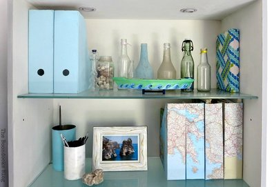 Bookcases with blue and green and maps