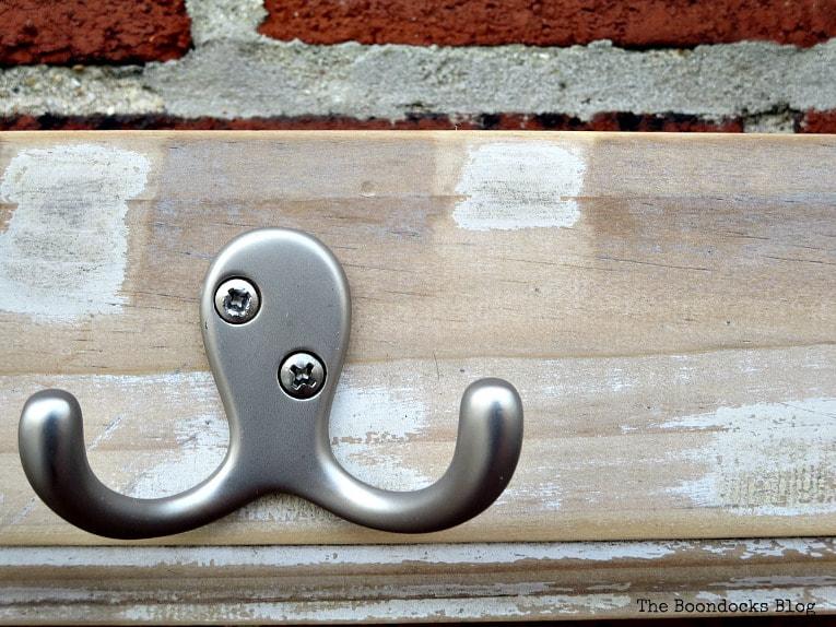 closeup of rustic wood and hook, How to Make an Easy Rustic Hook Rack www.theboondocksblog.com