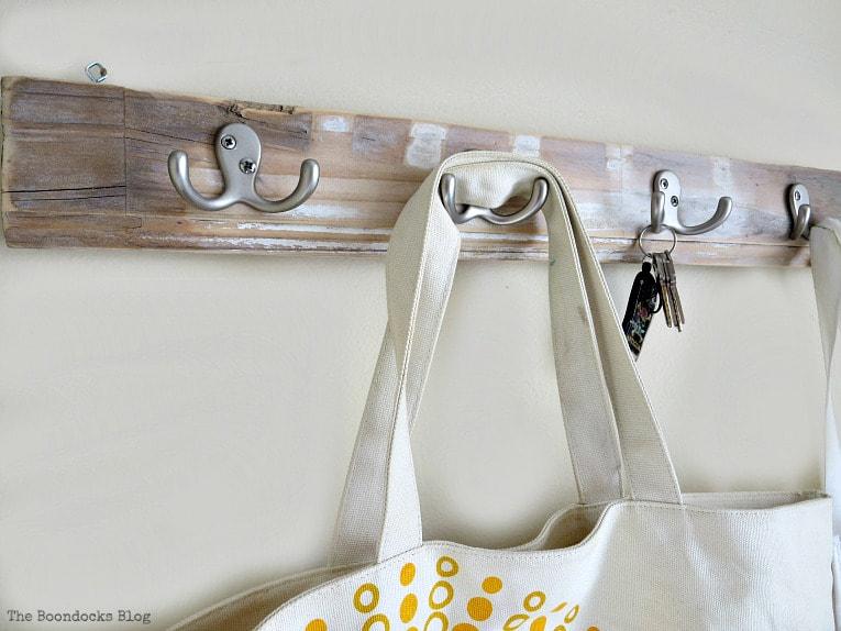 close up of rustic wood rack, How to Make an Easy Rustic Hook Rack www.theboondocksblog.com