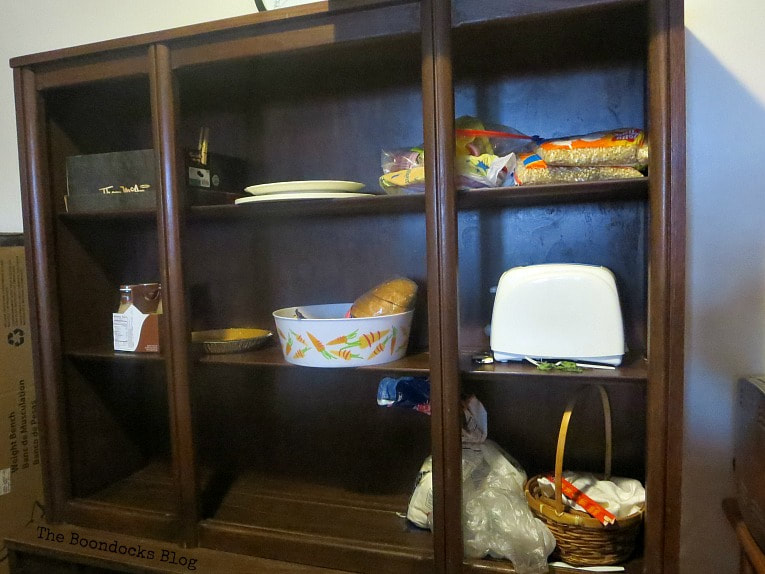 The top of the cabinet as storage, How to Makeover a Mid-Century Modern China Cabinet, www.theboondocksblog.com