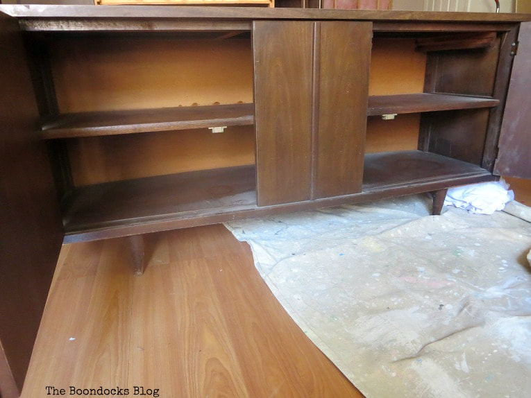 The bottom part of the cabinet with opened doors, How to Makeover a Mid-Century Modern China Cabinet, www.theboondocksblog.com
