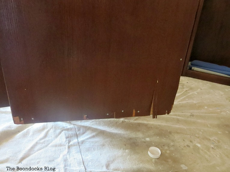 The side of the bottom cabinet with damaged veneer, How to Makeover a Mid-Century Modern China Cabinet, www.theboondocksblog.com