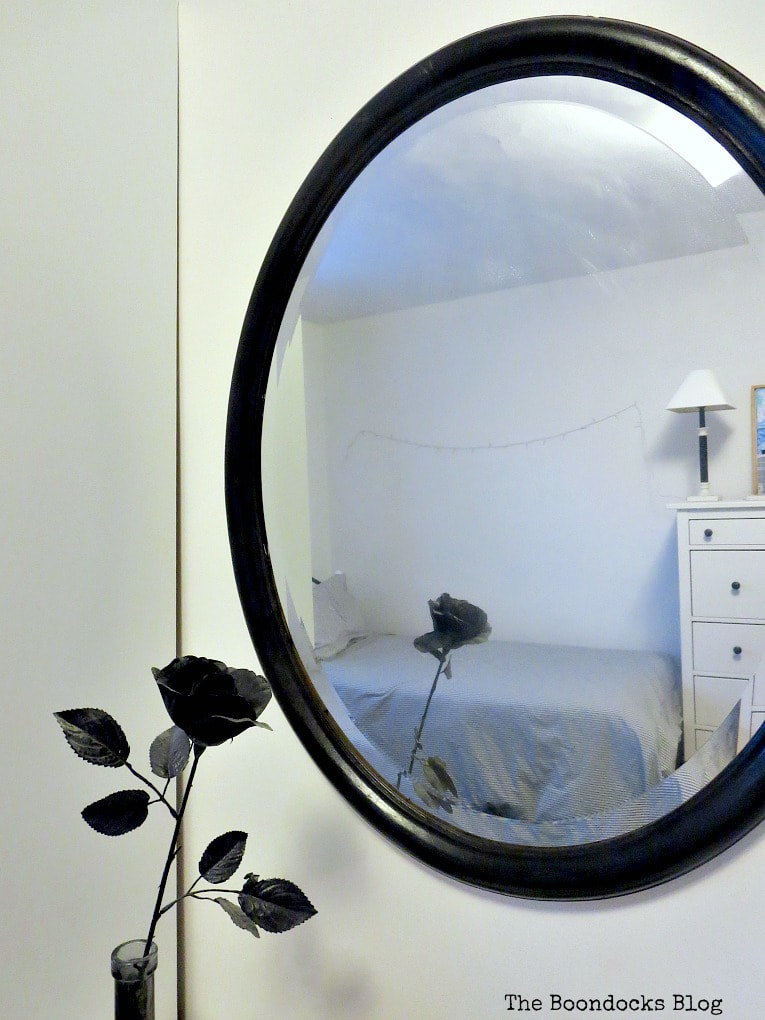 Black painted mirror with black rose, How to Revive an Old Wood Mirror with Paint www.theboondocksblog.com