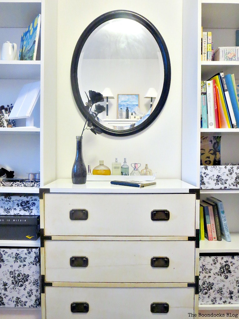 Black painted mirror over dresser and flanked by bookcases, How to Revive an Old Wood Mirror with Paint www.theboondocksblog.com