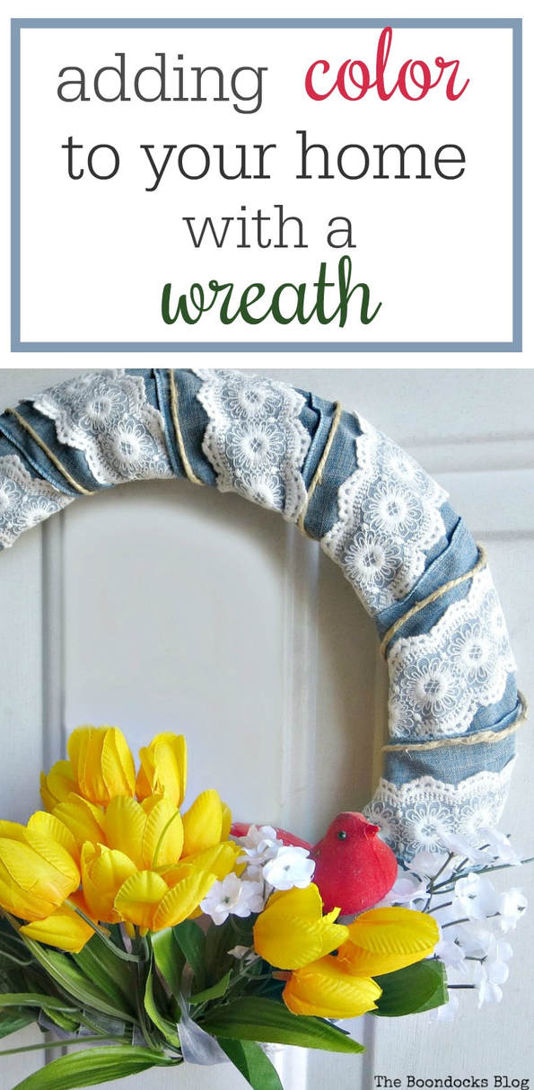 What is my favorite way to decorate? With wreaths which add color to your home and are easy to make. A tutorial on how to make an easy and frugal spring wreath with ribbon, faux flowers and a red cardinal. #SpringWreath #EasyDecorating #FauxFloralWreath #FrugalWreath How to Add Color to your Home with Wreaths www.theboondocksblog.com