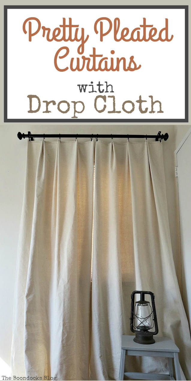 Finished handmade drop cloth curtains mounted on a black rod.