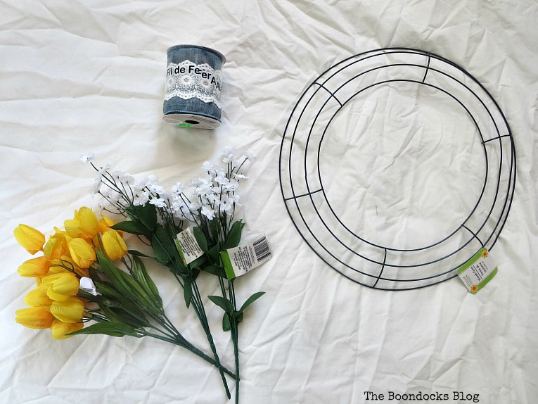 wreath form, flowers and blue ribbon, How to Add Color to your Home with Wreaths www.theboondocksblog.com