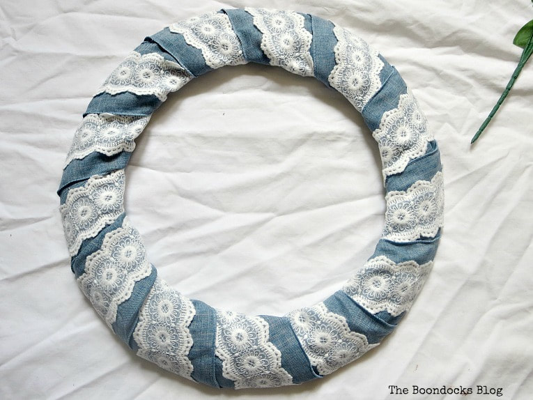 Blue ribbon with lace wrapped around wreath form, How to Add Color to your Home with Wreaths www.theboondocksblog.com