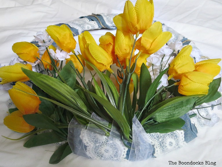 Adding yellow tulips on the bottom of wreath, How to Add Color to your Home with Wreaths www.theboondocksblog.com