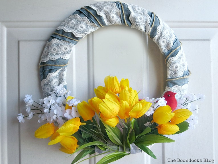 Spring wreath with white flowers and yellow tulips, How to Add Color to your Home with Wreaths www.theboondocksblog.com