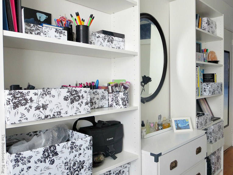 campaign dresser flanked by two Billy bookcases, full of storage boxes and a black mirror in the center, A Tour of the (mostly) black and white bedroom www.theboondocksblog.com