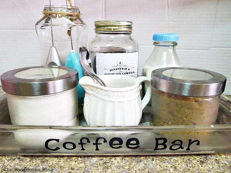 The coffee station is all ready and organized How to Make a Fun and Sloppy Coffee Station www.theboondocksblog.com