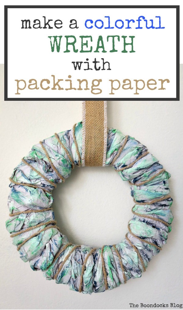 Easy DIY wreath made with colorful packing paper and text overlay.