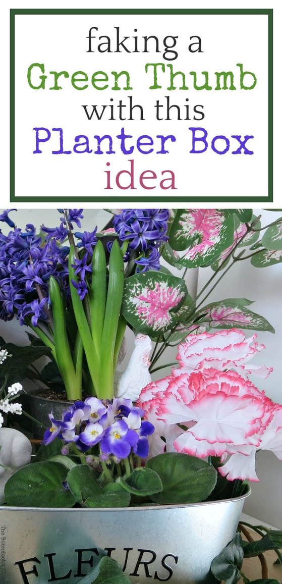 Real and faux flowers placed in three galvanized metal planter boxes #fauxflowers #DollarStoreCrafts #Planterboxideas #fauxgreenthumb How to Fake A Green Thumb with this Planter Box Idea, www.theboondocksblog.com