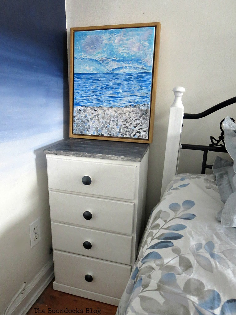 A repaired and revived night stand with paint, wood filler, metallic paint and contact paper, #furnituremakeover #metallicacrylicpaints #DecoArtProducts #Nightstand #furnitureupcycle #BlackandWhitefurniture How to Repair and Revive a Tired Night Stand www.theboondocksblog.com