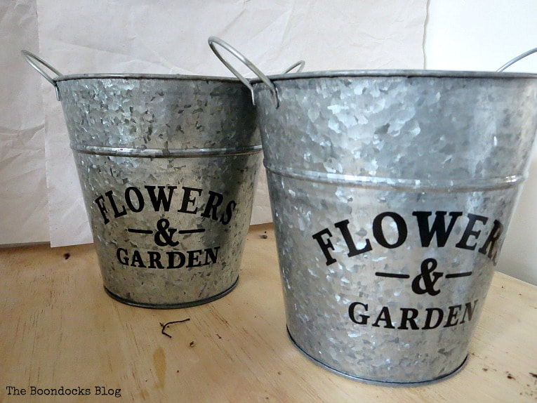 Two galvanized metal planters, How to Fake A Green Thumb with this Planter Box Idea, www.theboondocksblog.com
