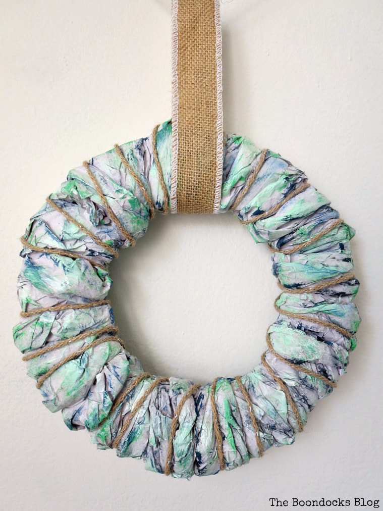 Easy DIY wreath made with colorful packing paper.