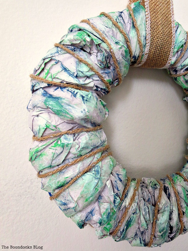 Close up of an easy DIY wreath made with colorful packing paper.
