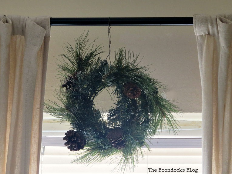 Previous pine wreath in living room, How to Make a Colorful Wreath with Packing Paper, www.theboondocksblog.com