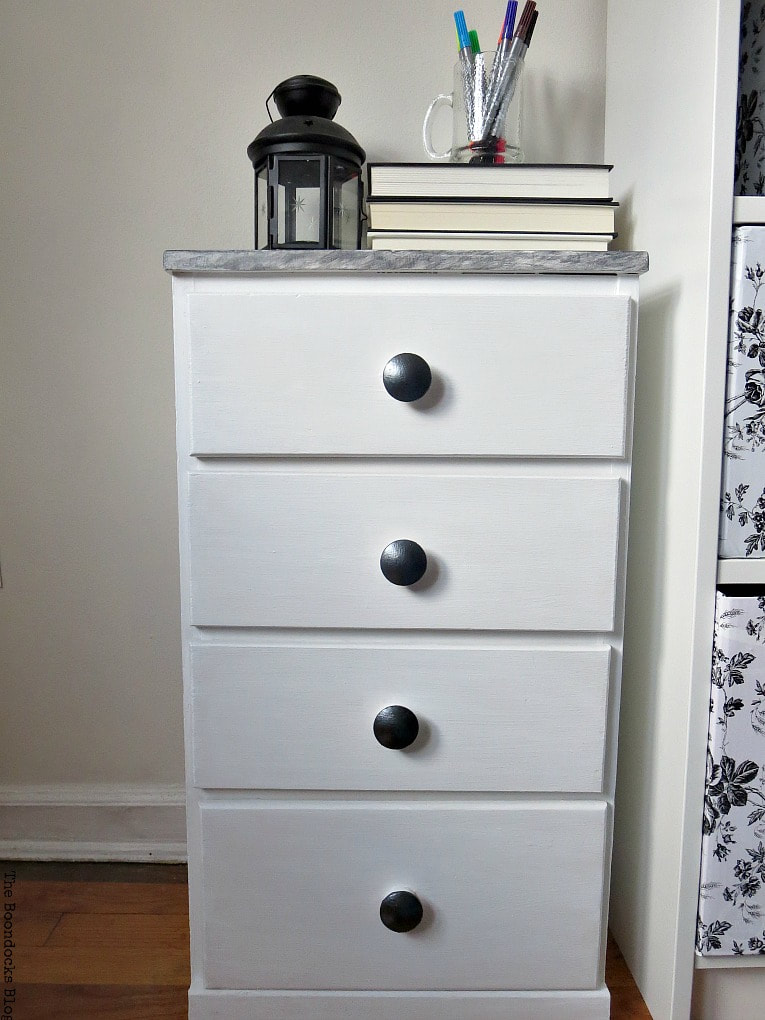 A repaired and revived night stand with paint, wood filler, metallic paint and contact paper, #furnituremakeover #metallicacrylicpaints #DecoArtProducts #Nightstand #BlackandWhitefurniture How to Repair and Revive a Tired Night Stand www.theboondocksblog.com