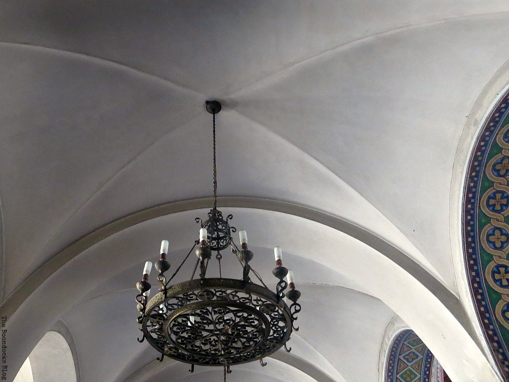 arched ceiling with no color and chandelier, Admiring the Interior of Saint Andrew's Cathedral www.theboondocksblog.com