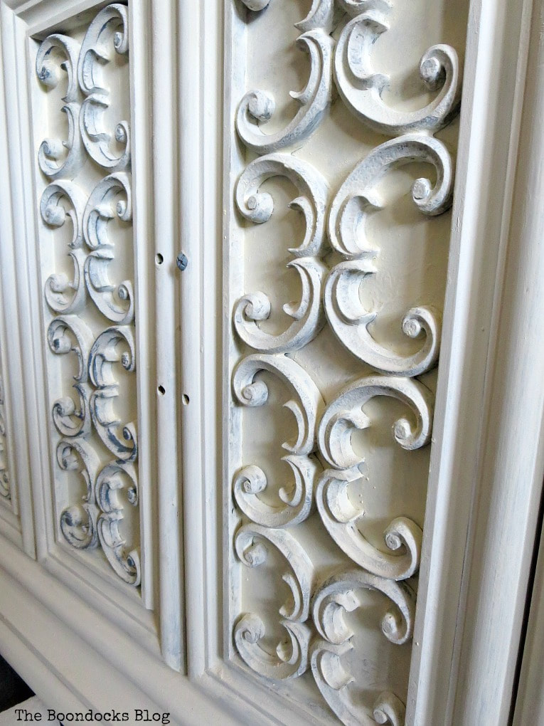 painting scroll work with milk paint, How to Revive a Vintage TV Cabinet www.theboondocksblog.com