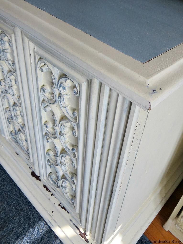 Scroll work and slate top of cabinet, #furnituremakeover #Vintagefurniture #SeventiesTVCabinet #OldFashionedMilkPaint #TVCabinetasstorage #ScrollworkonTVCabinet How to Revive a Vintage TV Cabinet www.theboondocksblog.com