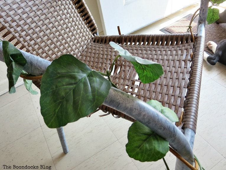 Painted metal on rattan chair with faux vines wrapped around the frame, How to re-purpose a torn rattan chair, www.theboondocksblog.com