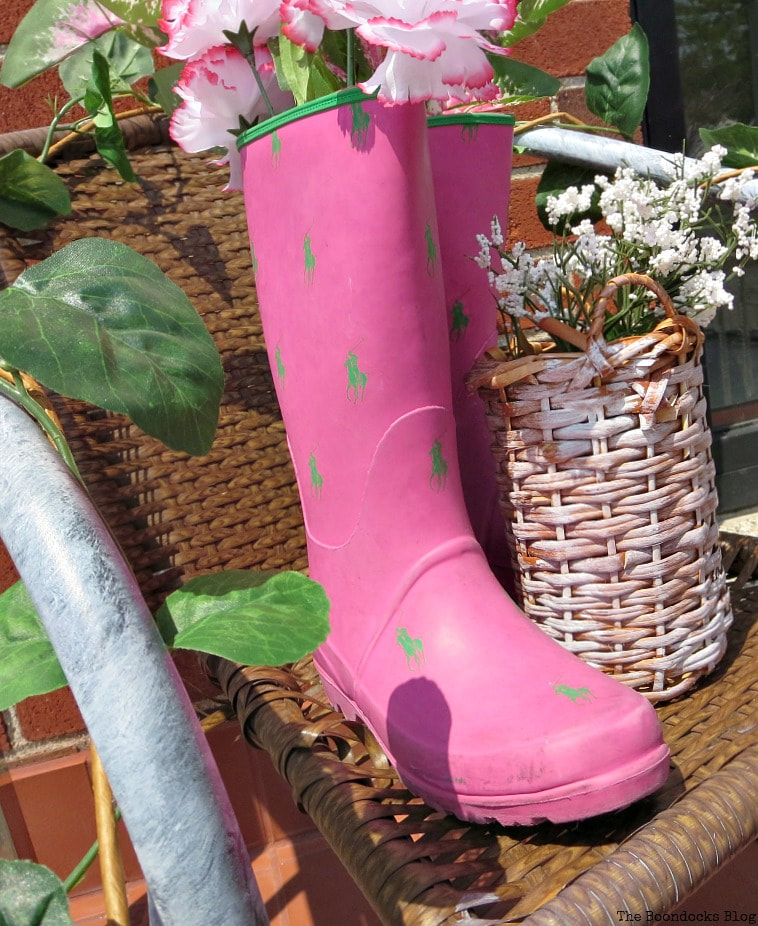 repurposed rubber boots as flower holder, How to re-purpose a torn rattan chair, www.theboondocksblog.com
