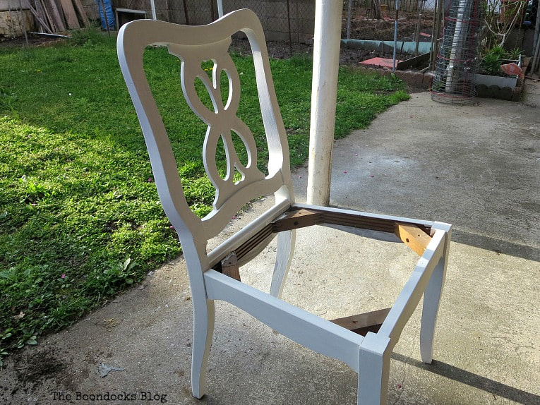 Chair painted in white with chalky finish paint, How to Get Two Unique Makeovers from One Chair www.theboondocksblog.com