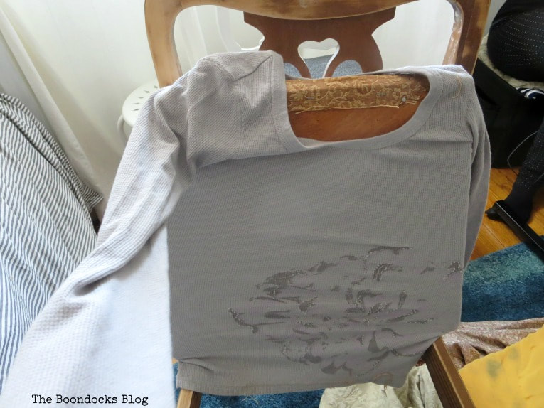 Placing the seat through a t-shirt to use as cover, How to Get Two Unique Makeovers from One Chair www.theboondocksblog.com