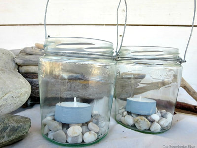 jars wrapped with wire to hold pebbles and tea lights