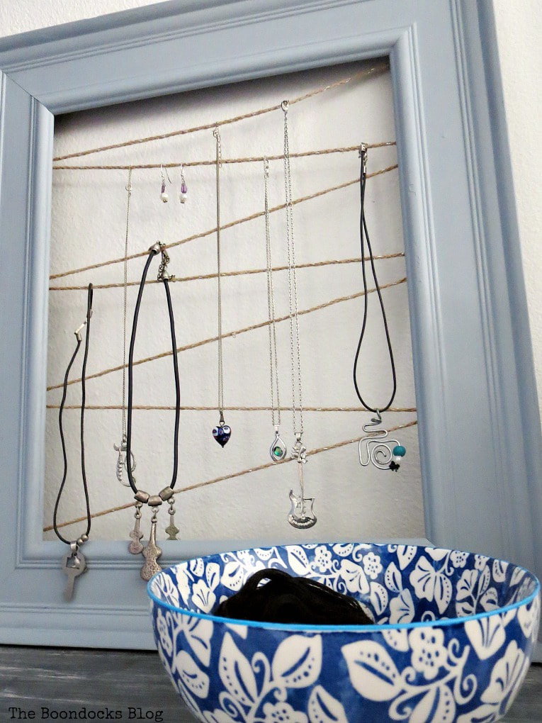 Jewelry organizer made with frame and twine, #Jewelryorganizer #repurpose #organize #frame #easyJewelryorganizer #DIYproject #Giftidea How to Make an Easy Frame Jewelry Organizer www.theboondocksblog.com