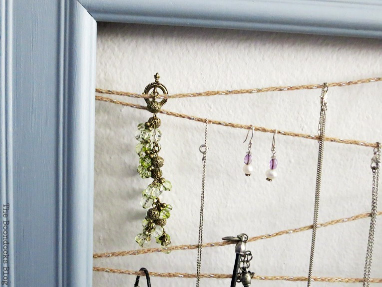 Jewelry organizer made with frame and twine, #Jewelryorganizer #repurpose #organize #frame #easyJewelryorganizer #DIYproject How to Make an Easy Frame Jewelry Organizer www.theboondocksblog.com