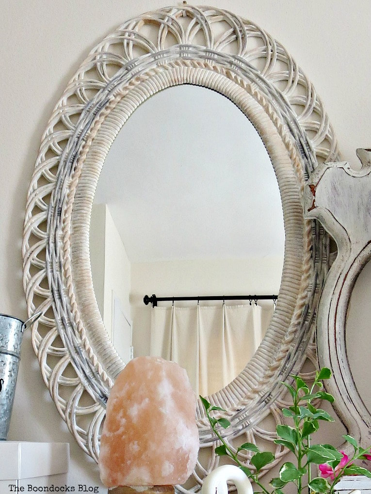 Oval plastic mirror frame painted with white, grey and peach, #Mirrorframemakeover #Shabbychicmirror #Vintagelookmirror #chalkyfinishpaint #paintingoverplastic #easyupcycle How to Save a Plastic Mirror from the Yard Sale www.theboondocksblog.com
