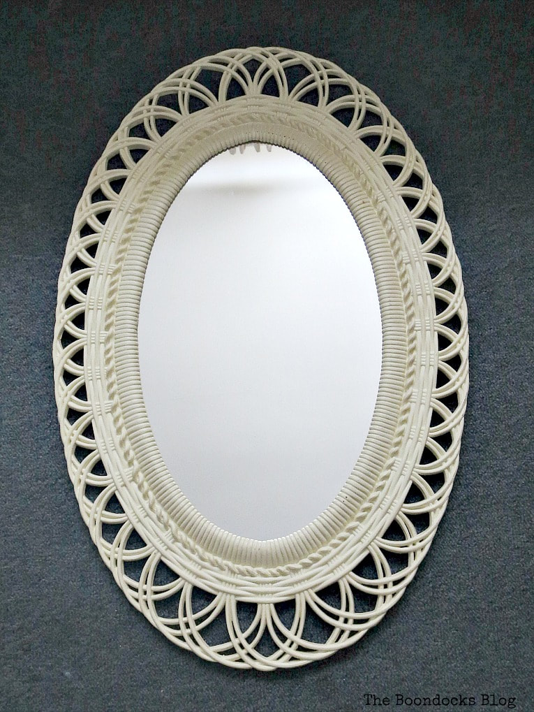 Oval plastic mirror before, #Mirrorframemakeover #Shabbychicmirror #Vintagelookmirror #chalkyfinishpaint #paintingoverplastic #easyupcycle How to Save a Plastic Mirror from the Yard Sale www.theboondocksblog.com