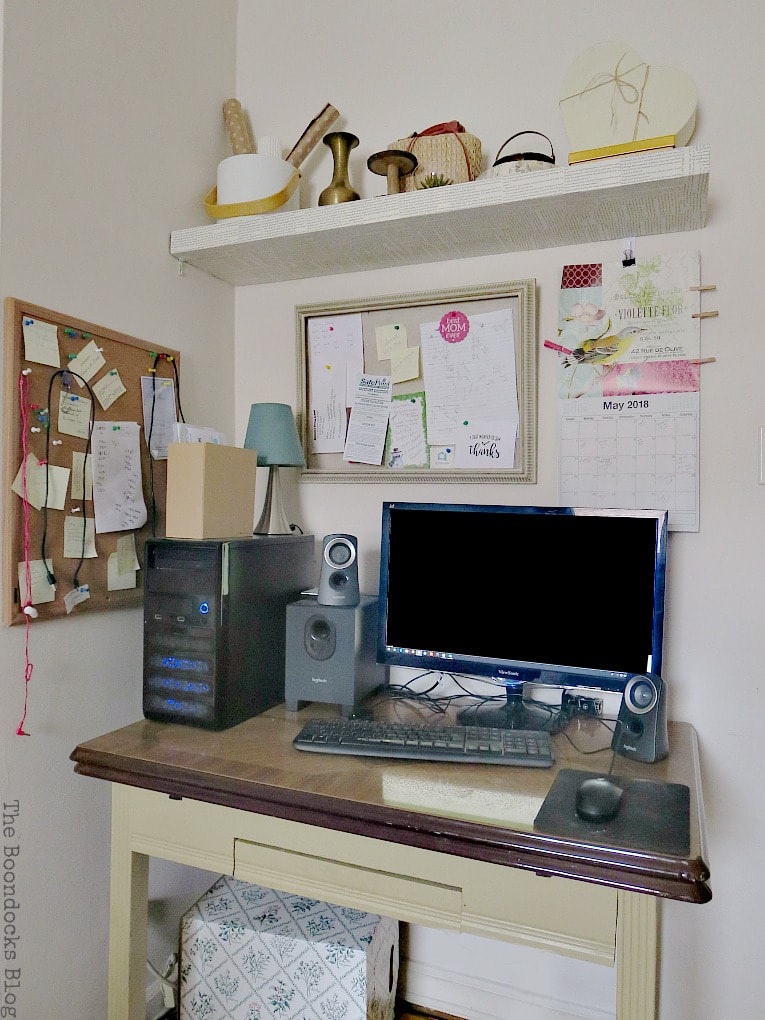 The work area with desk and shelf, #IkeaLackwallshelf #Modpodge #Decoupageproject #Shelftransformation #Newlookfordarkshelf #Bookpageideas #easyDIYproject How to Change the Look of a Shelf with Book Pages www.theboondocksblog.com