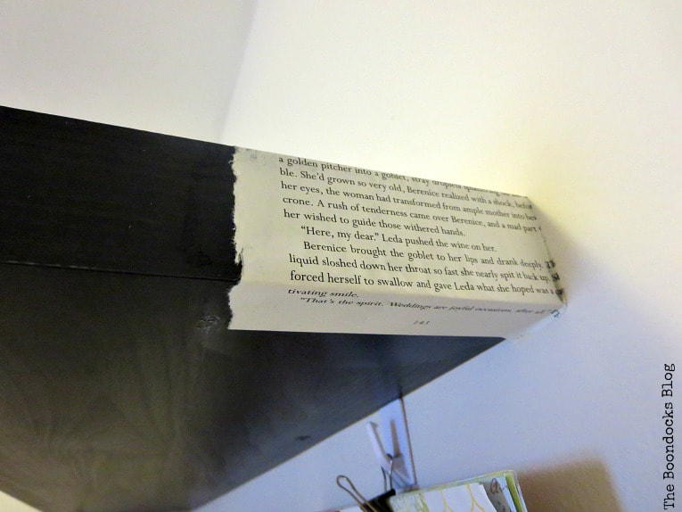 book pages being applied around the edges, How to Change the Look of a Shelf with Book Pages www.theboondocksblog.com