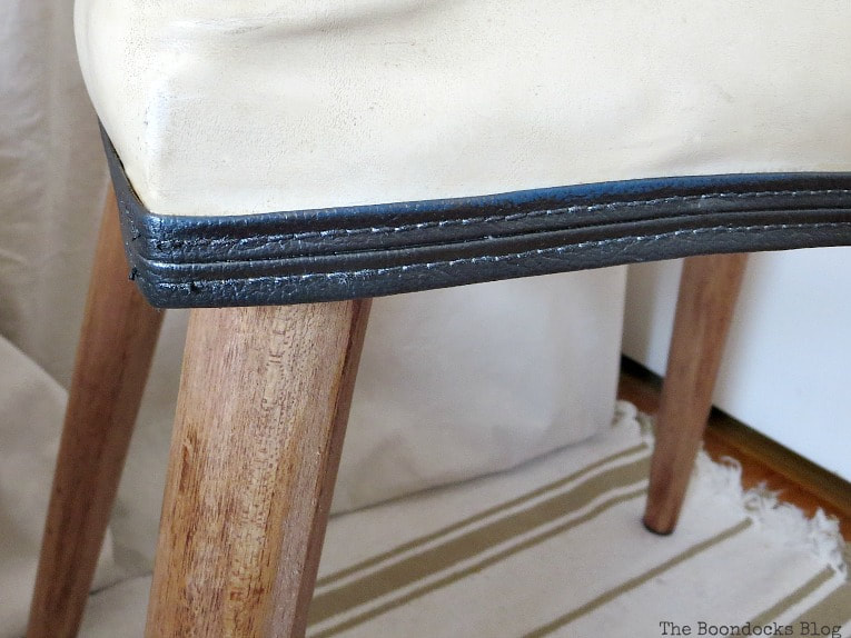 Closeup of painted vinyl piping, #Midcenturymodernbench #furnituremakeover #midcenturylegs #Vinylbench #furniturerefresh The Not So Simple Transformation of a Bench, www.theboondocksblog.com