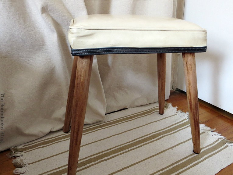 The finished small bench, #Midcenturymodernbench #furnituremakeover #midcenturylegs #Vinylbench #furniturerefresh The Not So Simple Transformation of a Bench, www.theboondocksblog.com