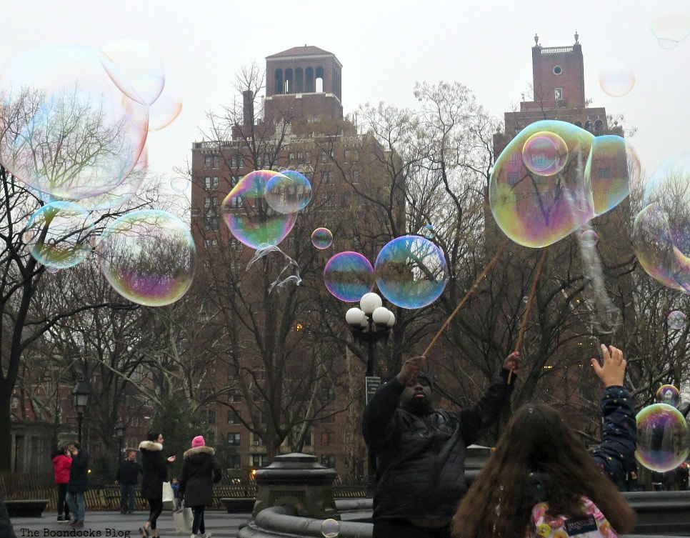 Man blowing bubbles in Washington Square Park, Interesting things to see in Greenwich Village www.theboondocksblog.com
