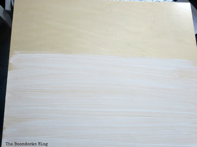Painting laminate board with chalky white paint.