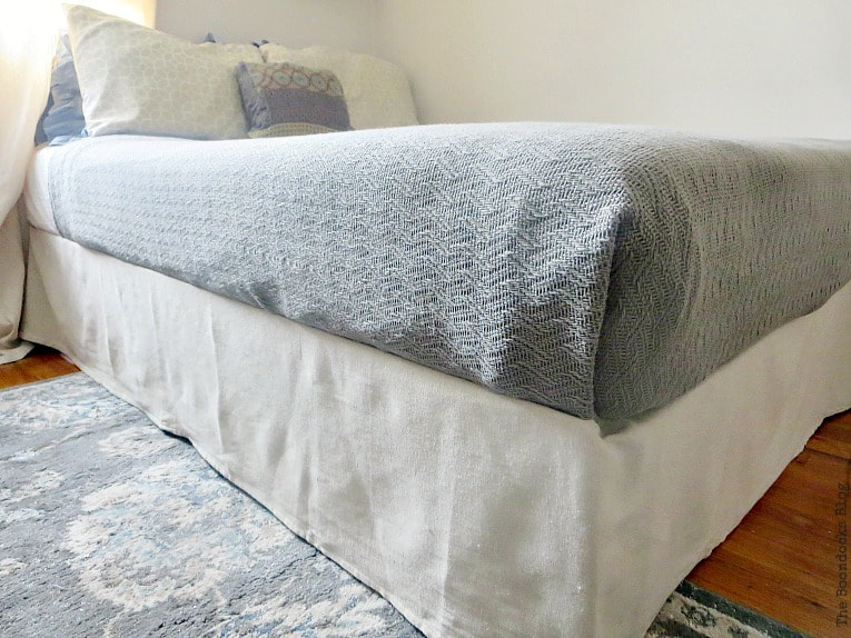 Canvas Drop cloth used as bed skirt, How to Make an Easy No-Sew Bed Skirt with Drop Cloth www.theboondocksblog.com