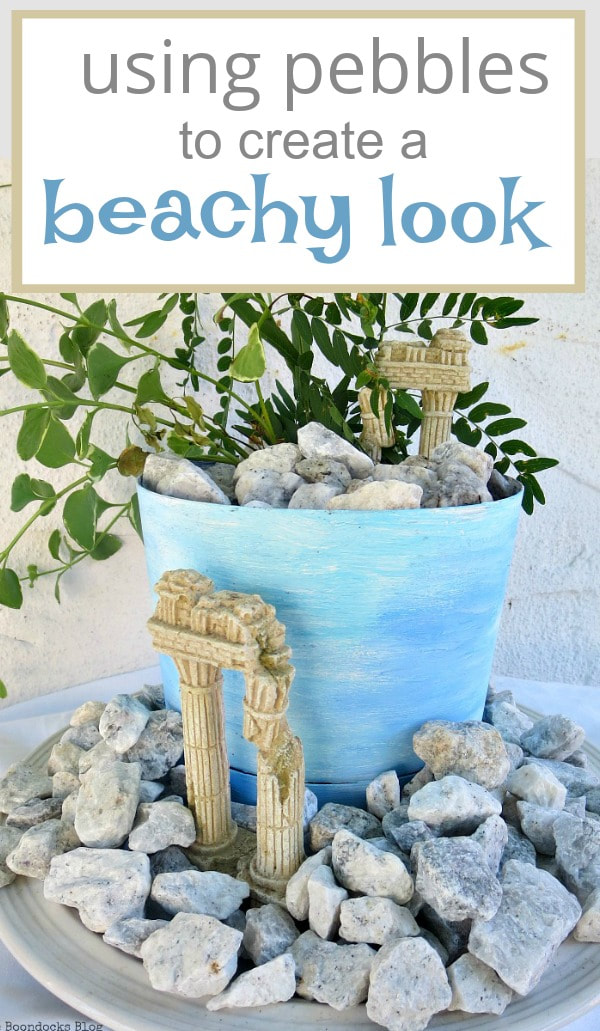 planter with a beachy ancient ruin look, #beachysummerlook #ancientruins #beachyplanter #Mediterranean #plantervignette #containerplanter #pebblerockproject #vincavine #easyproject #upcycledplanter Using Pebbles to Inspire My Love of the Beach www.theboondocksblog.com