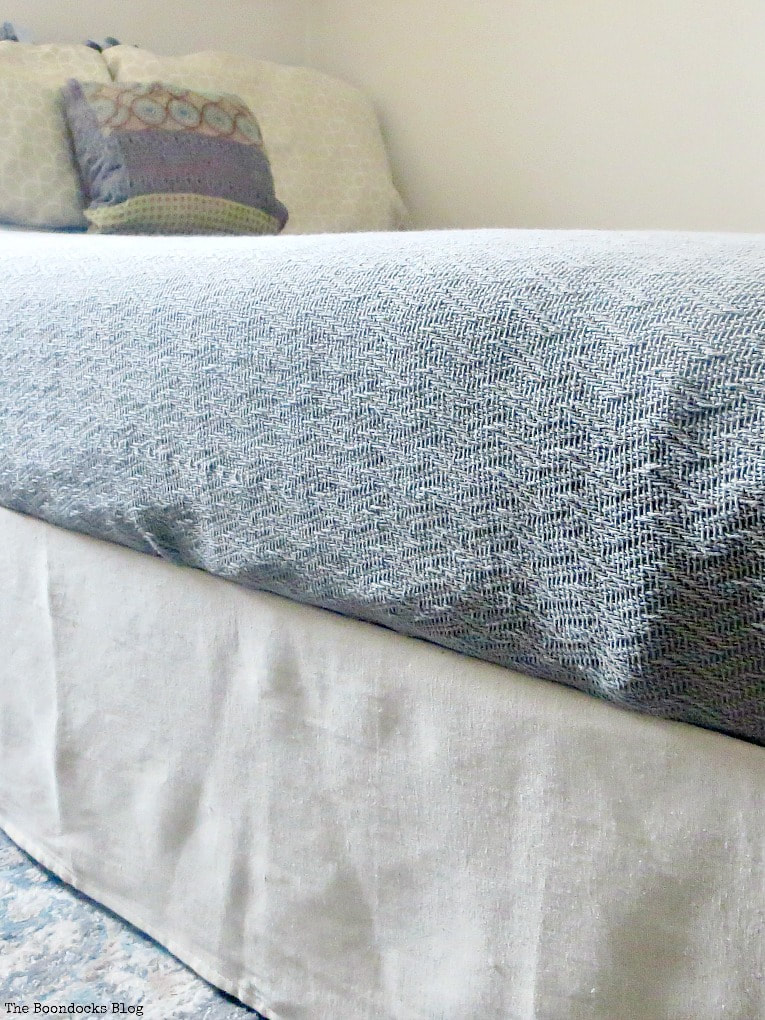 How to make a fast and easy no-sew canvas drop cloth bed skirt, #canvasdropcloth #bedskirt #fabric #storagesolutions #bedrisers #dropclothbedskirt #fastandeasysolution, How to Make an Easy No-Sew Bed Skirt with Drop Cloth www.theboondocksblog.com