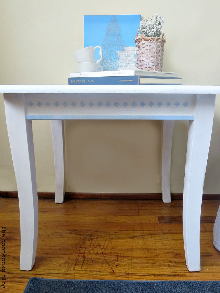 front of table with the details on the sides, #Farmhousetable #stencilmakeover #floralstencil #upcycledfurniture How to Give your Old Table a New Look with Stencils, the boondocksblog.com